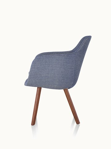 Side view of a Saiba Side Chair with blue upholstery and wood legs in a medium finish.