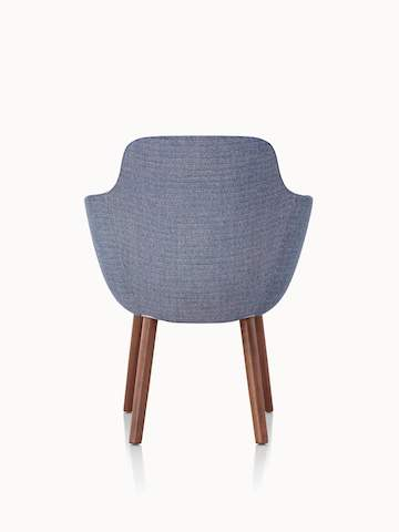 A Saiba Side Chair with blue upholstery and wood legs in a medium finish, viewed from behind.