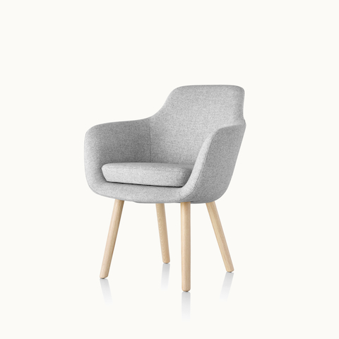 Angled view of a Saiba Side Chair with light gray upholstery and wood legs in a light finish. Select to go to the Saiba Side Chair product page.
