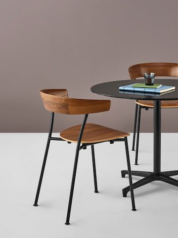 Two Leeway side chairs complement a black Saiba occasional table with a round top.