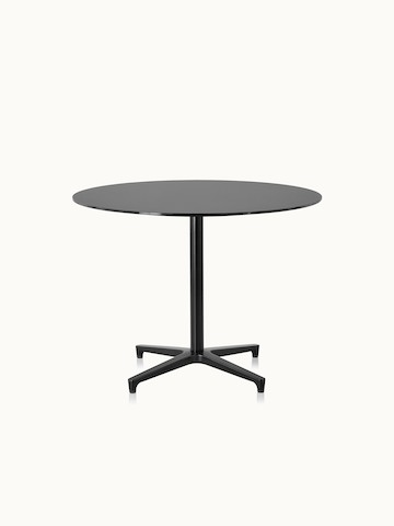 A round Saiba occasional table with a black  top and base.