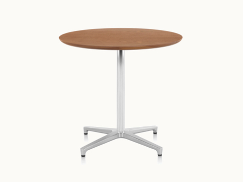 A round Saiba occasional table with a veneer top and aluminum pedestal base.