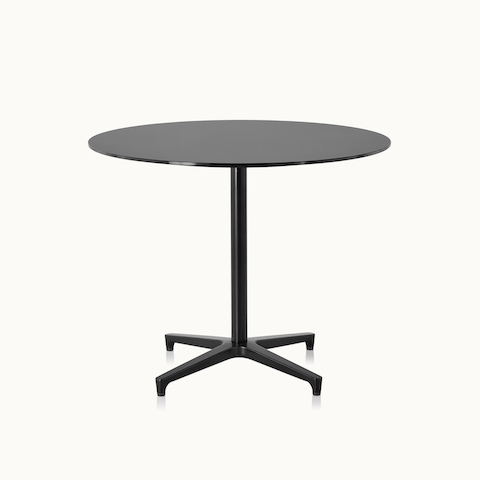 A round Saiba occasional table with a black top and base. Select to go to the Saiba Tables product page.