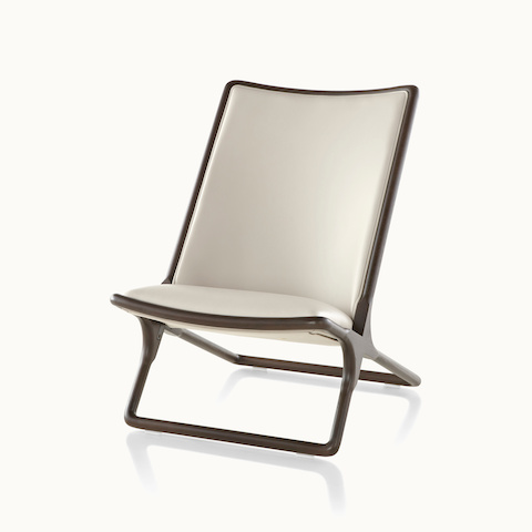 Angled view of a Scissor lounge chair with ivory-colored leather upholstery. Select to go to the Scissor Chair product page.