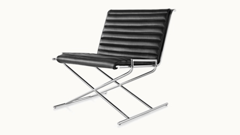 Angled view of a Sled lounge chair with black leather upholstery and an X-shaped steel frame.