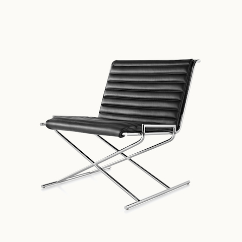 Angled view of a Sled lounge chair with black leather upholstery and an X-shaped steel frame. Select to go to the Sled Chair product page.