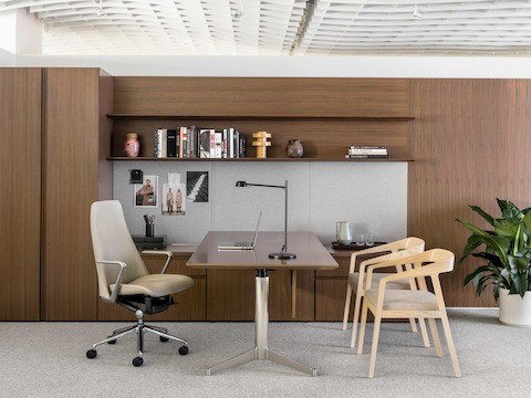 An executive office featuring Geiger Levels Casegoods, a beige leather Taper office chair, and two Full Twist Guest Chairs.