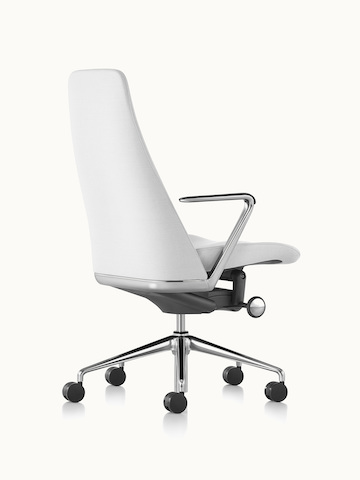 A Taper office chair upholstered in off-white fabric, viewed from behind at an angle.