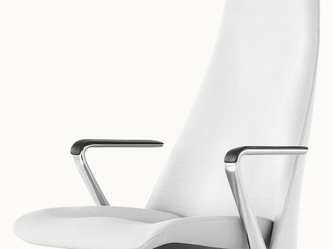 Angled view of the seat and back of a Taper office chair upholstered in off-white fabric.