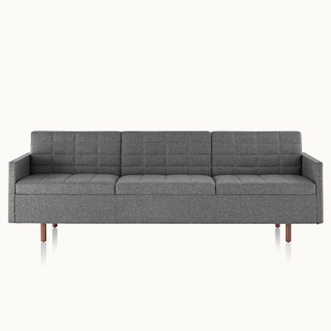A Tuxedo Classic sofa with dark gray quilted upholstery, viewed from the front.