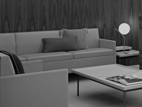 Black-and-white image of a sitting area featuring Tuxedo Classic Lounge Seating and a Tuxedo Component coffee table.