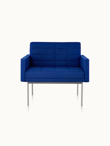 A quilted Tuxedo Component club chair upholstered in blue fabric, viewed from the front.