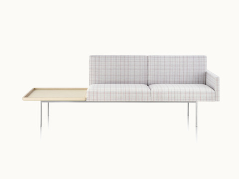 A non-quilted Tuxedo Component settee with plaid upholstery and an attached table, viewed from the front.