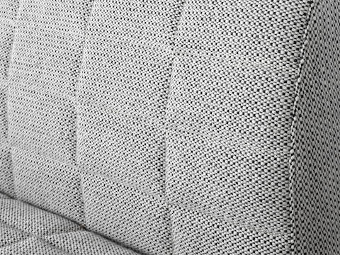 Close-up of the quilted upholstery available on Tuxedo Component Lounge Seating.