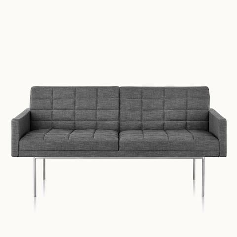 A quilted Tuxedo Component settee upholstered in gray fabric, viewed from the front.