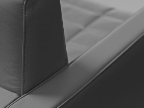 Close-up of a back corner on a Tuxedo Component club chair, showing the stitching detail.
