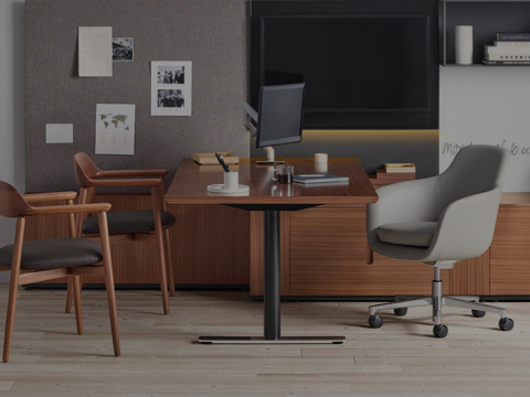 Partial view of an executive office featuring Geiger Rhythm Casegoods, a Saiba office chair, and Crosshatch side and lounge chairs.