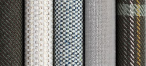 A row of seven textiles from Geiger's Brighton Collection in various colors and patterns.