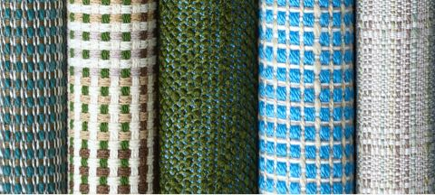 A row of six textiles from Geiger's Framework Collection in various colors and patterns.