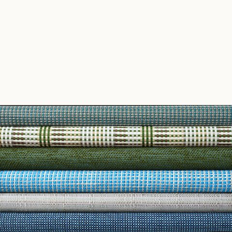 A stack of six textiles from Geiger's Framework Collection in various colors and patterns.