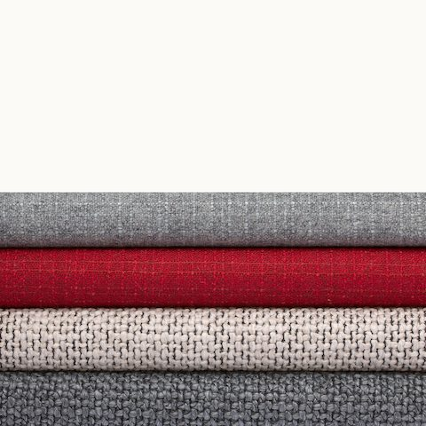 A stack of four Milaner and Capri textiles from Geiger in various colors.