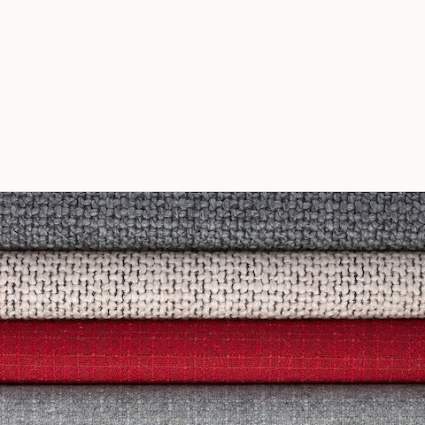 A stack of four Milaner and Capri textiles from Geiger in various colors. Select to go to the Milaner and Capri page.