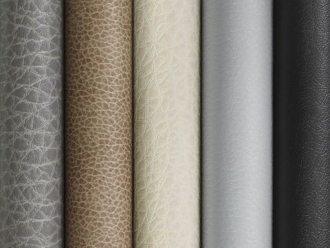A stack of textiles featuring polyurethane in gray, brown, and tan tones.
