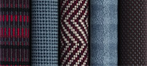 A row of six textiles from Geiger's Sartorial Collection in various colors and patterns.